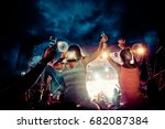 crowd with raised hands at... | Shutterstock . vector #682087384