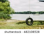 old tire swing hanged on a tree.... | Shutterstock . vector #682108528
