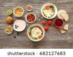 tasty breakfast with yogurt on...   Shutterstock . vector #682127683