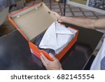 opening the box of a new pair... | Shutterstock . vector #682145554