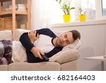 man falling asleep at home... | Shutterstock . vector #682164403
