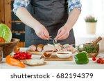 male preparing chicken for...   Shutterstock . vector #682194379