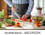 male cooking healthy salad | Shutterstock . vector #682195234