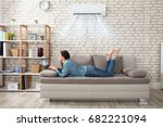 Woman Lying On Sofa Using...