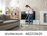 happy young woman cleaning the... | Shutterstock . vector #682223620