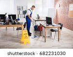 male janitor cleaning floor... | Shutterstock . vector #682231030