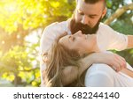 man hugging and looking woman... | Shutterstock . vector #682244140