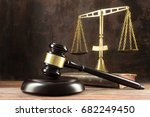 judge gavel  book and scales on ... | Shutterstock . vector #682249450