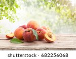 Ripe Peaches With Leaves On A...