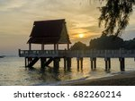 sunset at jetty | Shutterstock . vector #682260214