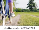 active woman riding bicycle.... | Shutterstock . vector #682263724