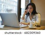 serious businesswoman talking... | Shutterstock . vector #682309360