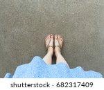 female feet wear sandals and... | Shutterstock . vector #682317409