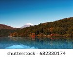 red torii gate on the shore of... | Shutterstock . vector #682330174
