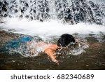my boy playing in waterfall.   Shutterstock . vector #682340689