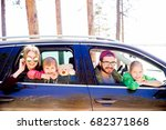 family in a car | Shutterstock . vector #682371868