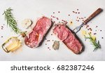 raw beef striploin steaks with... | Shutterstock . vector #682387246