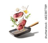 flying raw beef steaks  with... | Shutterstock . vector #682387789