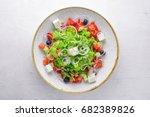 greek salad of fresh vegetables ... | Shutterstock . vector #682389826