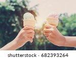 children's hands holding ice... | Shutterstock . vector #682393264
