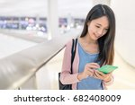 woman use of mobile phone in... | Shutterstock . vector #682408009