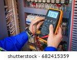 electrical engineer adjusts... | Shutterstock . vector #682415359