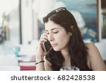 Small photo of Serious woman concentrate listening smartphone conversation