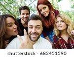 group of friends taking selfie... | Shutterstock . vector #682451590