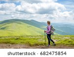 young woman hiking in the... | Shutterstock . vector #682475854