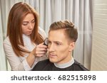 young man getting a haircut.... | Shutterstock . vector #682515898