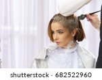 hair dyeing process. young...   Shutterstock . vector #682522960
