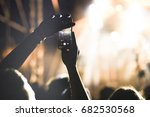 crowd with raised hands at... | Shutterstock . vector #682530568