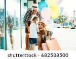 happy family with shopping bags ... | Shutterstock . vector #682538500