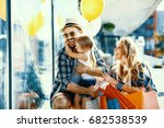 happy family with shopping bags ... | Shutterstock . vector #682538539
