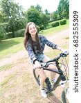 girl teenager on a bicycle   Shutterstock . vector #682555309