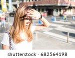 a women raise her hand to cover ... | Shutterstock . vector #682564198