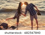 two young adult lovers standing ... | Shutterstock . vector #682567840