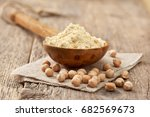 Chickpea Flour In A Wooden...