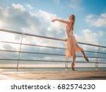 dancing ballerina in beige silk ... | Shutterstock . vector #682574230