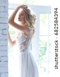 beautiful young bride in white... | Shutterstock . vector #682584394