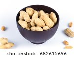 peanuts in a wooden bowl on a... | Shutterstock . vector #682615696