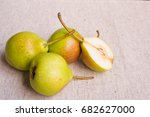 Four Pears On A Linen Tablecloth