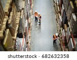 above view of warehouse workers ... | Shutterstock . vector #682632358