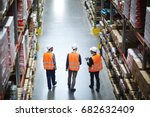 group of warehouse workers... | Shutterstock . vector #682632409