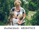 grandmother playing in the park ... | Shutterstock . vector #682647613