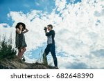 young couple on the hill  man... | Shutterstock . vector #682648390