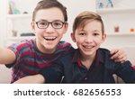 two handsome teenage boys... | Shutterstock . vector #682656553