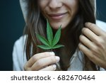woman smiling holding a...   Shutterstock . vector #682670464