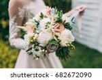 wedding bouquet in the hands of ... | Shutterstock . vector #682672090