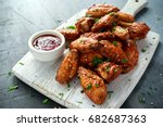 baked chicken wings with sesame ... | Shutterstock . vector #682687363